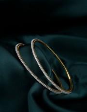 Buy a creative collection of Diamond Bangles Design Online.